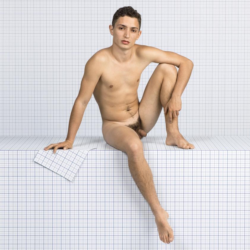 Naked Boy Sitting Down, Looking Towards Camera