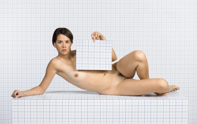 Naked Girl Reclining, Looking Towards Camera